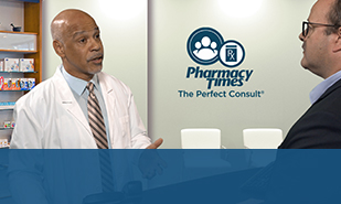 Pharmacist speaking to patient